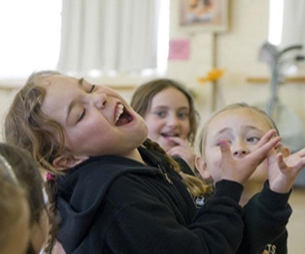 Girl Singing in Class